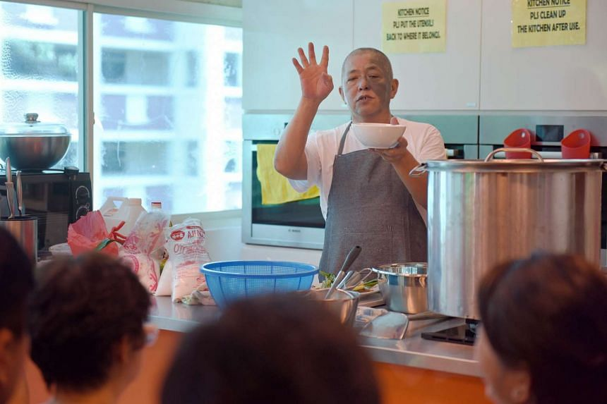 Mr Neo Cheng Leong,  owner of Leong Hainanese Chicken Rice at Shunfu Market, conducting a cooking class at Henderson Community Centre on May 29, 2017.