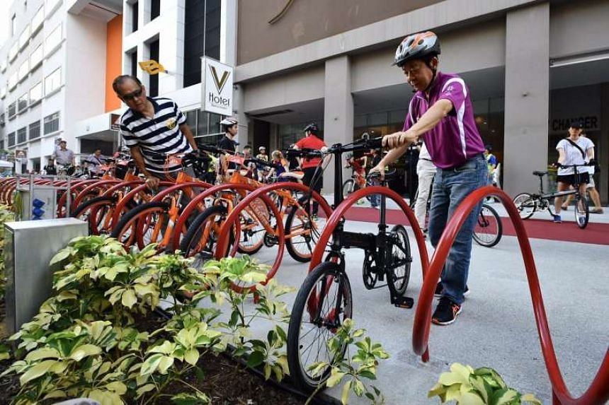 Coordinating Minister for Infrastructure and Minister for Transport Khaw Boon Wan parking his bicycle at the launch of the revitalised Bencoolen Street, on May 28, 2017.