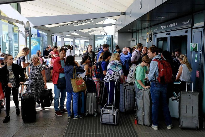 Travellers stranded outside the entrances of Heathrow Airport Terminal 5 on May 27, 2017.