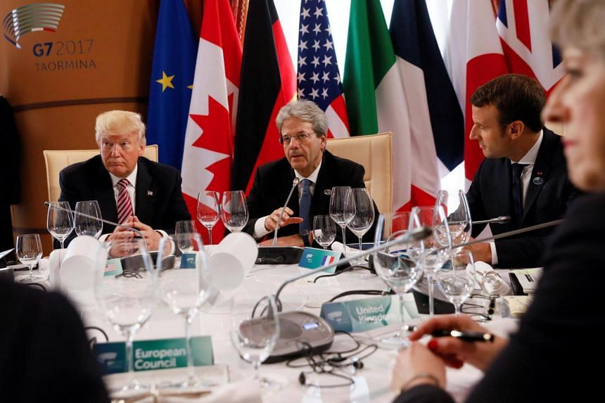 (From left) United States President Donald Trump, Italian Prime Minister Paolo Gentiloni, French President Emmanuel Macron and Britain's Prime Minister Theresa May in a discussion during the G7 Summit in Italy.