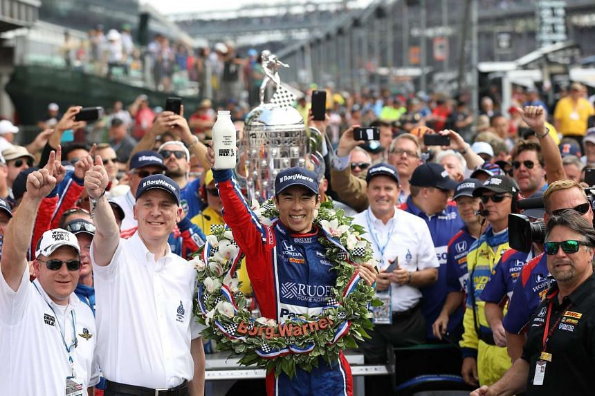 Japanese driver Takuma Sato of Andretti Autosport celebrates in Victory Circle after winning the 101th running of the Indianapolis 500 auto race at the Indianapolis Motor Speedway in Indianapolis, Indiana on 28 May 2017.