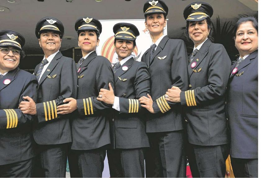 Indian women pilots from Air India pose for a photograph during an event on the eve of International Women's Day in New Delhi on March 7, 2017.