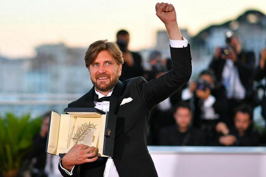 Swedish director Ruben Ostlund with his Palme d'Or award, which he won for the film The Square.