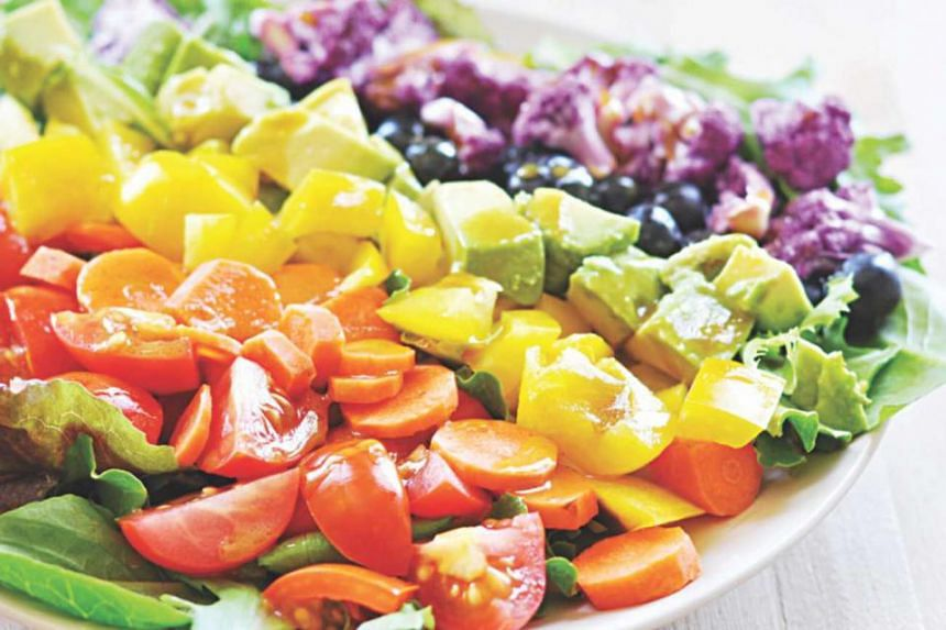 A rainbow salad with everything from tomatoes and carrots to pepper and avocado.