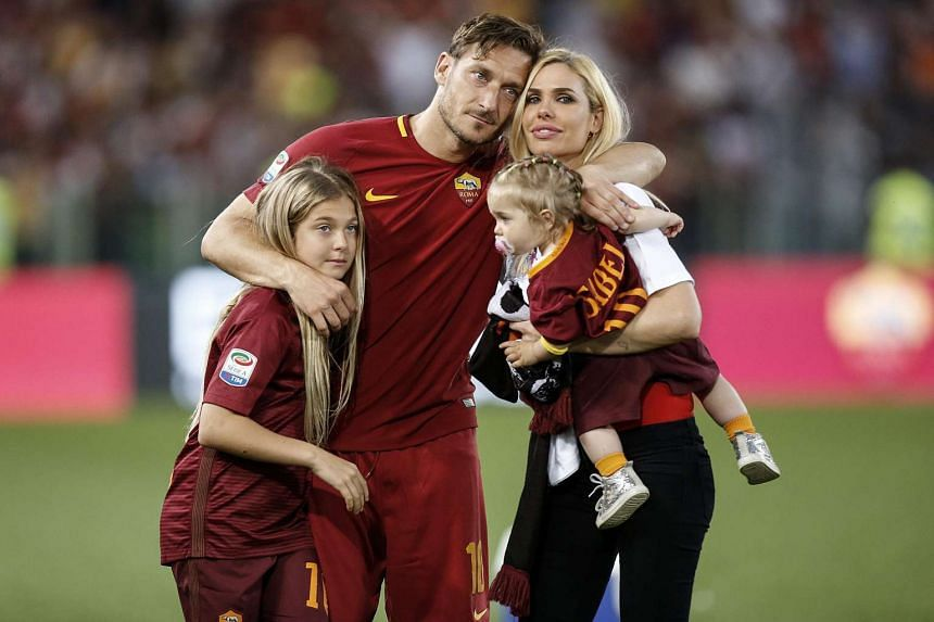 AS Roma's captain Francesco Totti with his family Isabel (right), Chanel (left) and his wife Ilary at Olimpico stadium in Rome on May 28, 2017.