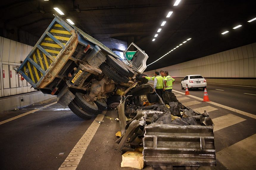 The tipper truck, which blocked most of the KPE's Nicoll Highway exit, was seen tilted awkwardly to its left side.