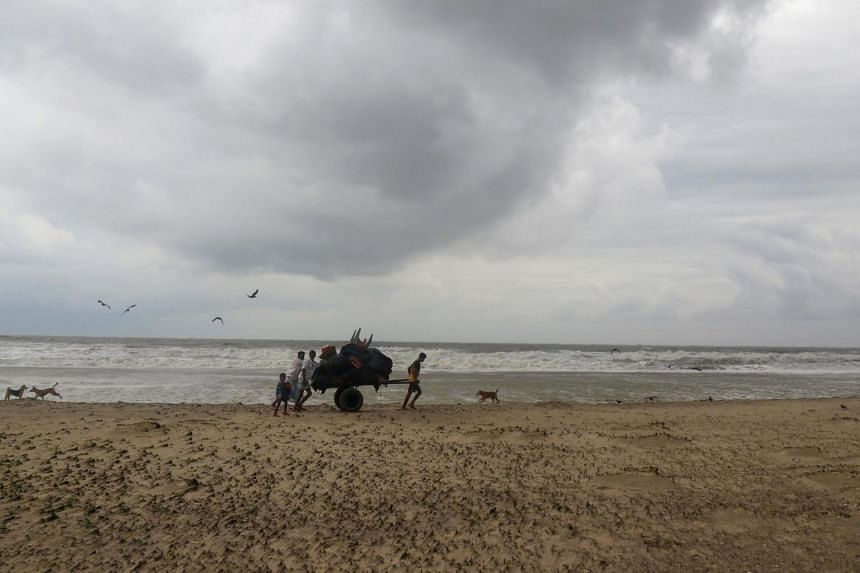 Bangladeshi villagers evacuate to cyclone shelters on the coast in Cox's Bazar district on May 30, 2017.