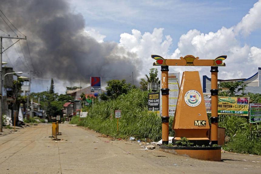 Smoke rises from burning houses following an air strike at Maute rebels stronghold as fighting between Islamist militants and government forces continues in Marawi city,