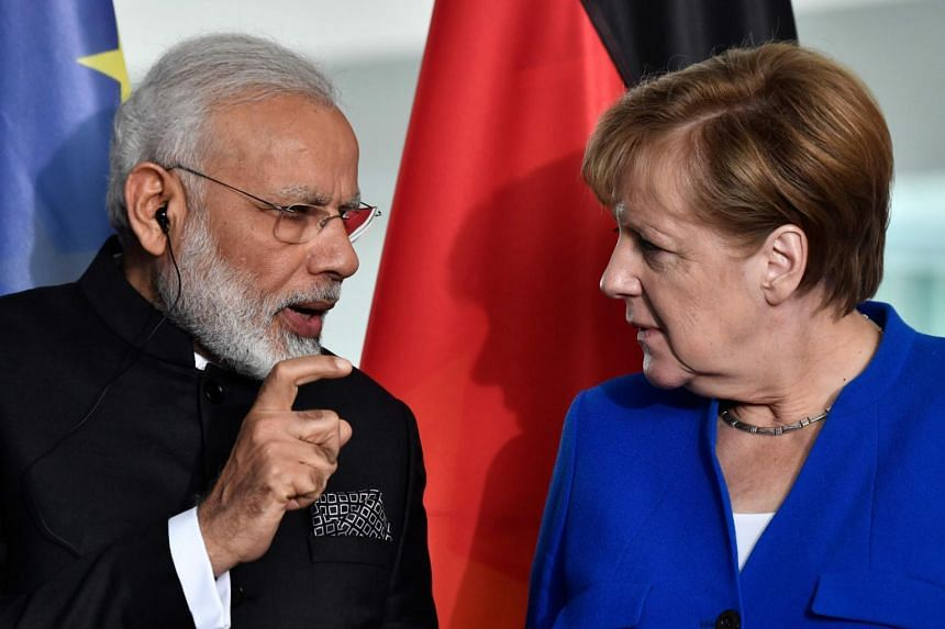 German Chancellor Angela Merkel and Indian Prime Minister Narendra Modi speak after a press conference following talks and the signing of agreements at the Chancellery in Berlin, on May 30, 2017.