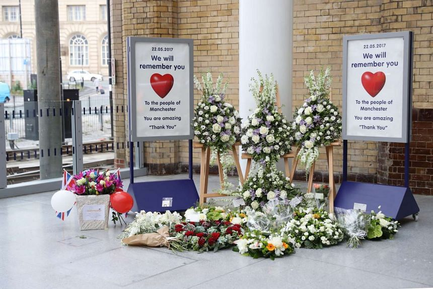 Floral tributes are placed at Manchester Victoria railway station on May 30, 2017, in Manchester.
