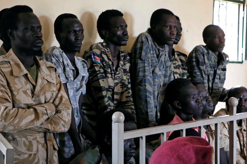 South Sudanese soldiers suspected of raping five foreign aid workers and killing their local colleague are seen before appearing in a military court in South Sudan's capital Juba, on May 30, 2017.