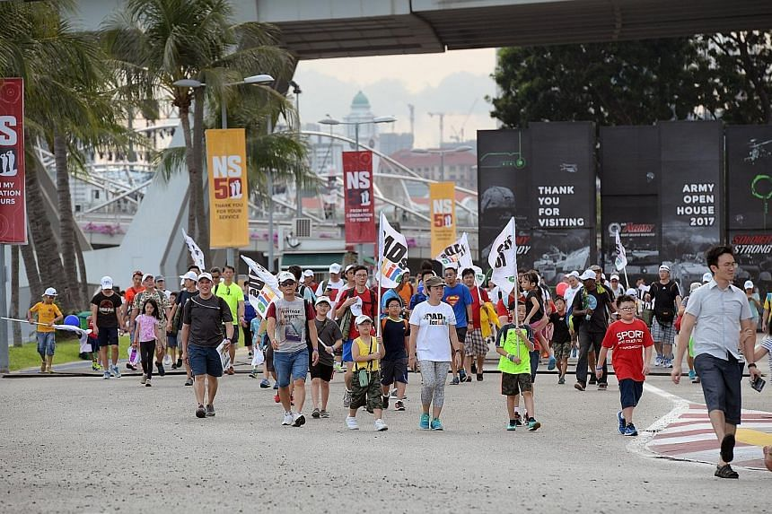 Participants of the Dads for Life Camp near the F1 Pit Building during the 3km Family Route March yesterday evening.