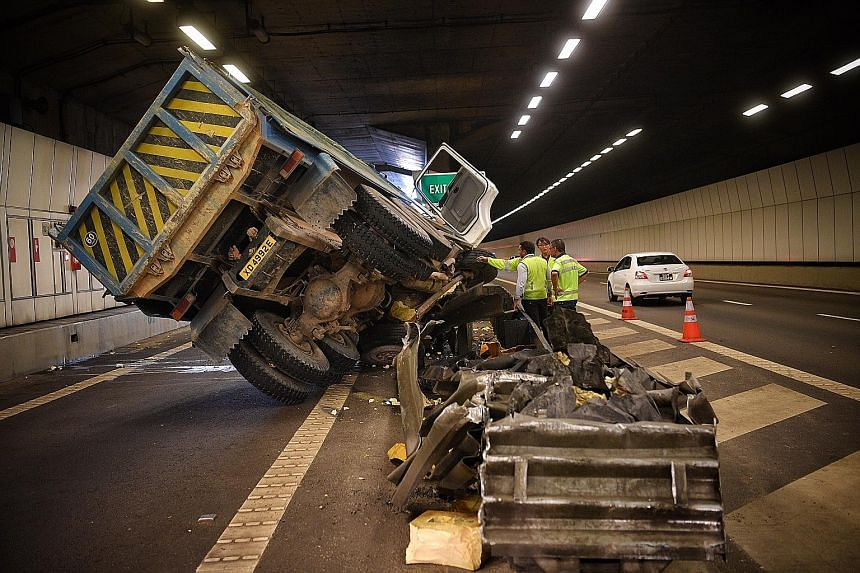 It took two cranes over an hour to move the tipper truck aside to clear the way to the Nicoll Highway exit. The truck had hit a tunnel wall, causing the driver to lose control of the vehicle, which then hit a divider.