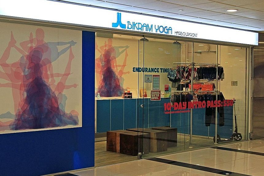 The storefront of Bikram Yoga Harbourfront at HarbourFront Centre yesterday. The studio was opened in 2012 and it is not known how many members it has. An e-mail from the studio on Sunday told members that it will be closing on July 1.