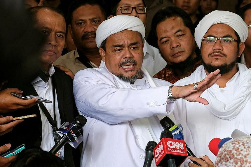 Habib Rizieq talking to reporters outside a court after the blasphemy trial of Jakarta's outgoing governor Basuki Tjahaja Purnama in the Indonesian capital in February.