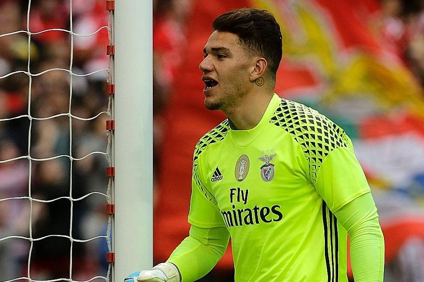Benfica goalkeeper Ederson celebrating a goal in the league against Vitoria, whom they beat again in Sunday's Cup final to complete a double. United are also keen on him as David de Gea is expected to leave.