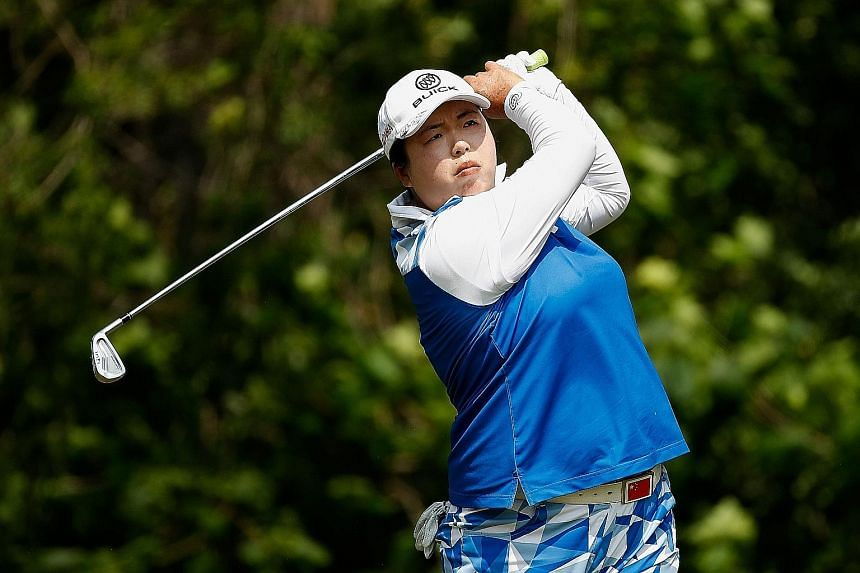 Feng Shanshan watching her tee shot on the seventh hole in the final round of the Volvik Championship. She won by a single stroke after surviving bogeys on two of the last three holes.