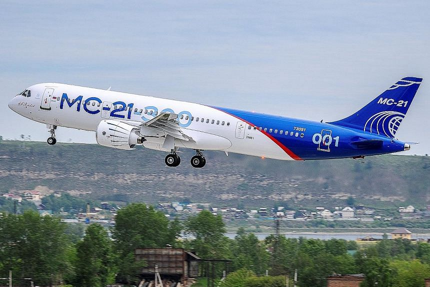 An MC-21 medium-haul passenger plane produced by Irkut Corporation taking off in Irkutsk, Russia, on Sunday. It can fly up to 6,000km and is designed for the mass-market travel industry.