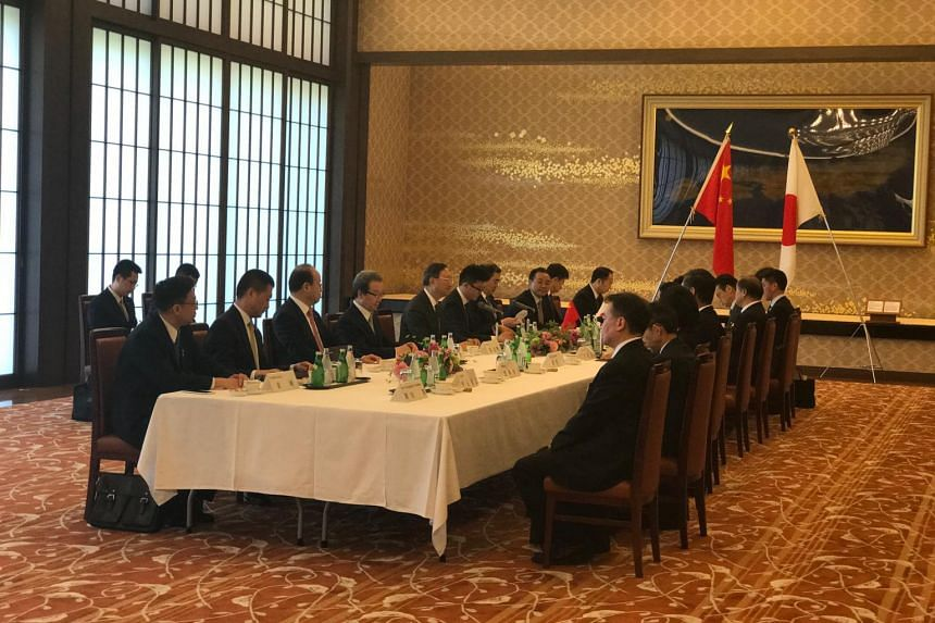Chinese State Councillor Yang Jiechi (fifth from left) meets Japanese Foreign Minister Fumio Kishida at the Iikura Guest House in Tokyo on May 30, 2017.