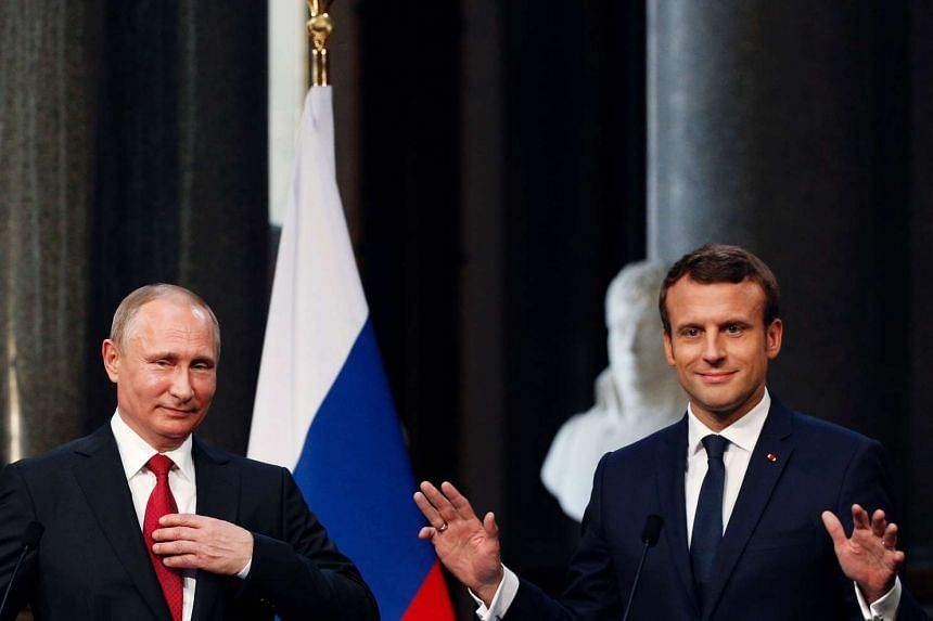 French President Emmanuel Macron (right) delivers a press conference with Russian President Vladimir Putin (left) at the Versailles Palace on May 29, 2017.