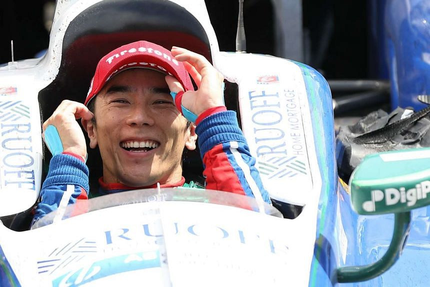 Japanese driver Takuma Sato celebrates after winning the 101st running of the Indianapolis 500 in the United States on May 28, 2017.