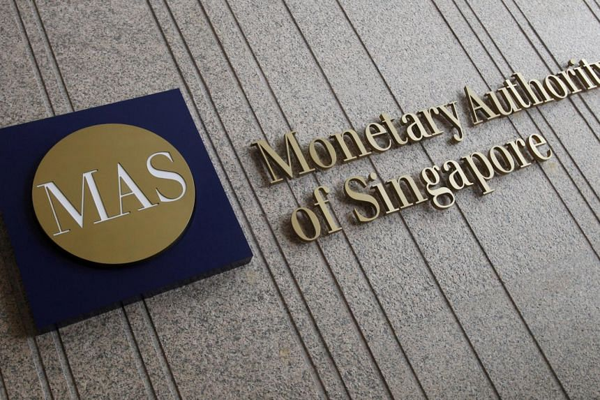 The logo of the Monetary Authority of Singapore (MAS) is pictured at its building in Singapore.