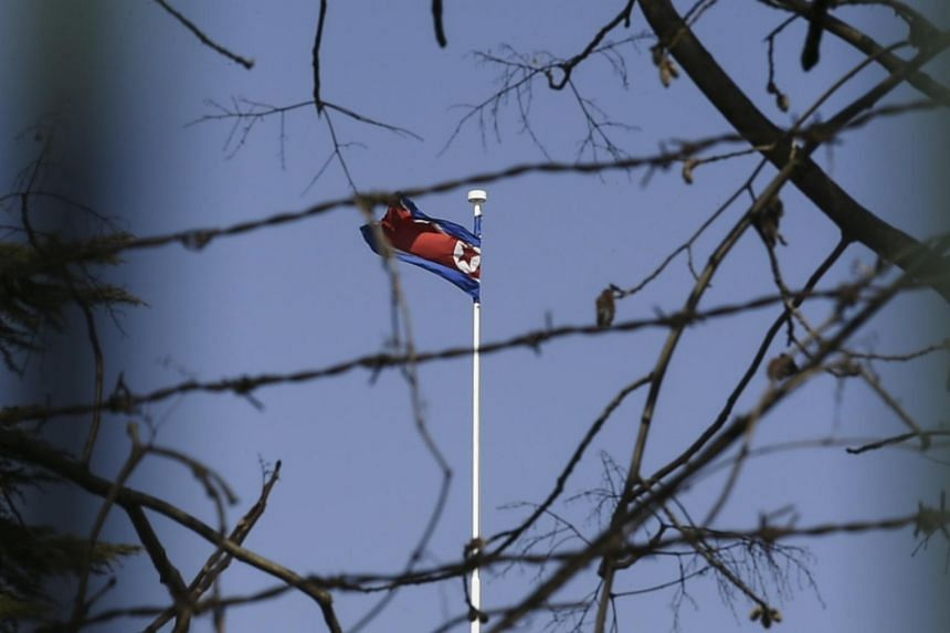 The North Korean national flag flying at the North Korean Embassy in Beijing.