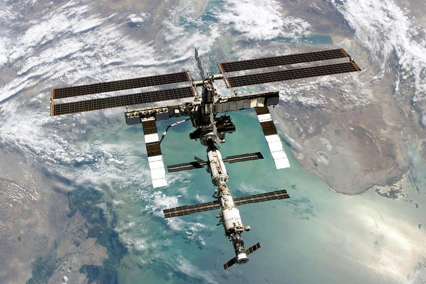 A file handout image from Nasa shows the International Space Station flying over the North Caspian Sea and Kazakhstan in 2005.