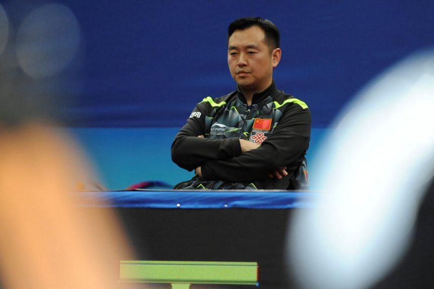 Chinese women's team head coach Kong Linghui watching a quarterfinals match during the 2017 Asian Table Tennis Championships, in Wuxi, Jiangsu province, on April 14, 2017.