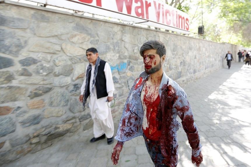 An injured man arrives at a hospital after the blast.