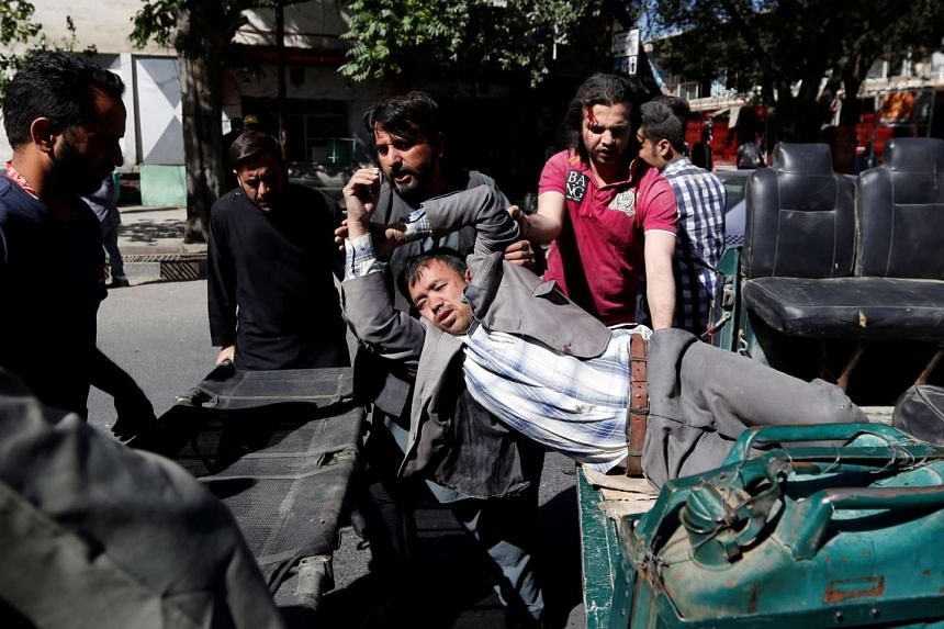 Men moving an injured man to a hospital after the blast.