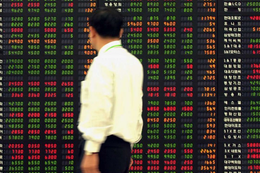 Shares in Shanghai rose after Chinese manufacturing data exceeded estimates, while stocks in Japan pared declines as the yen weakened.