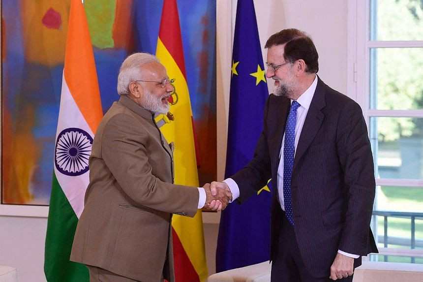 Indian Prime Minister Narendra Modi shaking hands with Spanish Prime Minister Mariano Rajoy in Madrid, Spain on May 31.