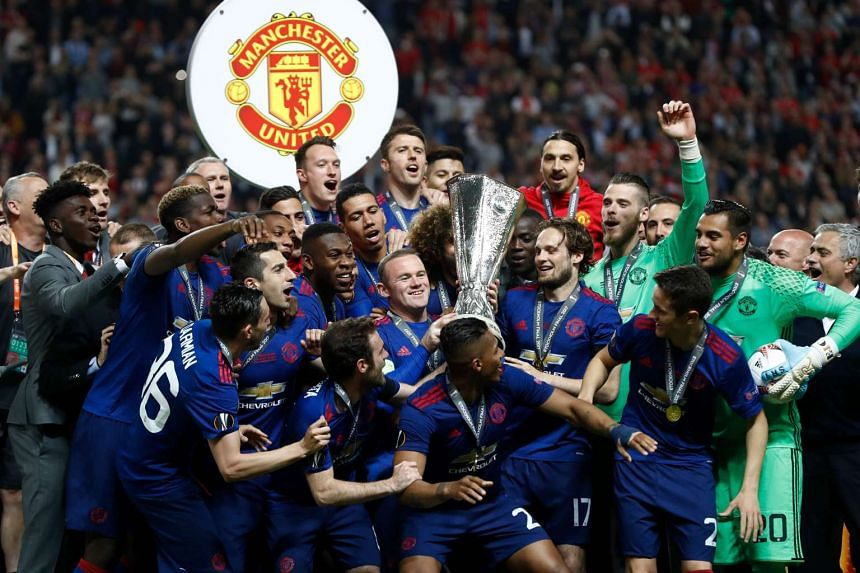 Manchester United players celebrating after the UEFA Europa League final football match Ajax Amsterdam v Manchester United on May 24, 2017, at the Friends Arena in Solna, Sweden.