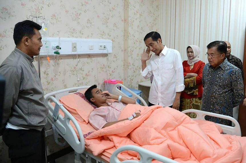 Indonesian Presidential Palace shows Indonesian President Joko Widodo (second from right) visiting one of the injured policemen after a suicide bombing near a Jakarta bus station on Thursday (May 25).