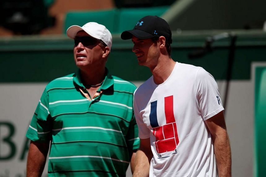 Coach Ivan Lendl talks to Britain's Andy Murray during a training session.