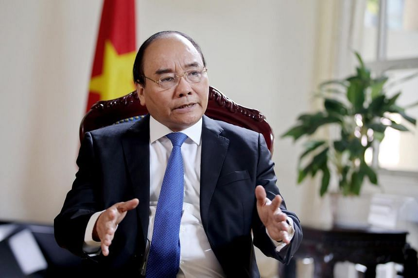 Vietnamese Prime Minister Nguyen Xuan Phuc speaks during an interview in Hanoi, Vietnam.