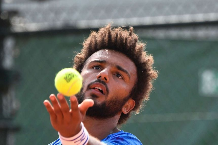 France's Maxime Hamou serving to Uruguay's Pablo Cuevas at the French Open on May 29, 2017.