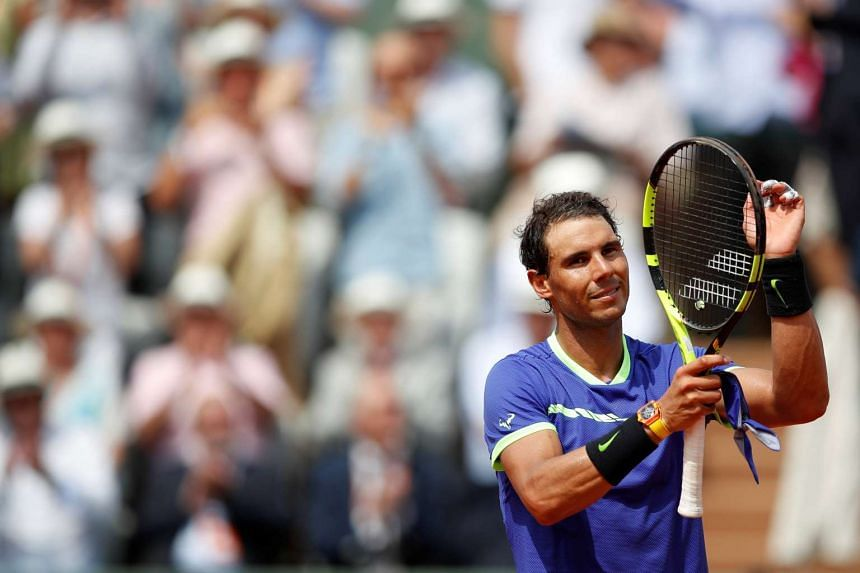 Spain's Rafael Nadal celebrates winning his first round match against France's Benoit Paire in Paris on May 29, 2017.