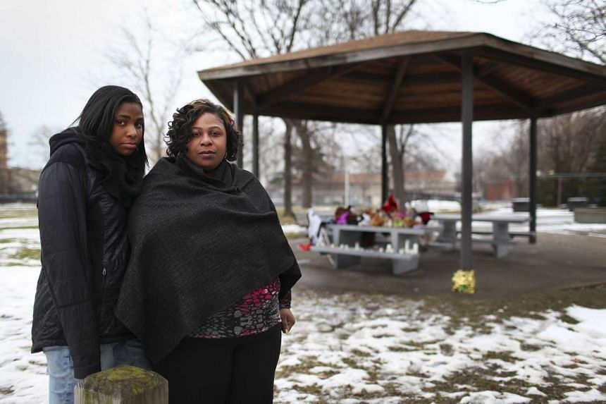 Mother Samaria Rice, right, with daughter Tajai at Cudell Commons, where 12-year-old Tamir was killed.