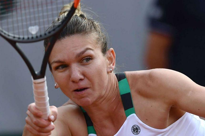 Halep returns the ball to Slovakia's Jana Cepelova.