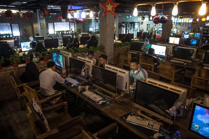 Chinese people at a Beijing internet cafe on May 31. China will adopt a controversial cybersecurity law from June 1 despite concerns from overseas companies and business groups in the country.