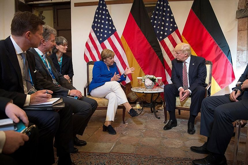 """German Chancellor Angela Merkel and US President Donald Trump meeting before talks at the G-7 summit in Italy last Friday. In the aftermath of Mr Trump's visit to Europe, Dr Merkel warned at an election rally in Munich: """"The times in which we can ful"""