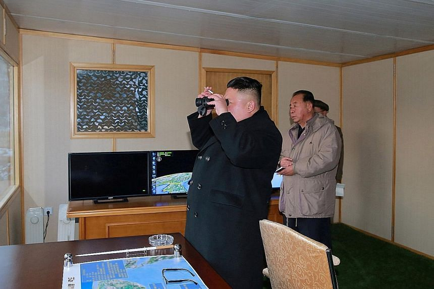 Mr Kim inspecting the test launch of Pukguksong-2 in an undated photo released by Korean Central News Agency on Feb 13.