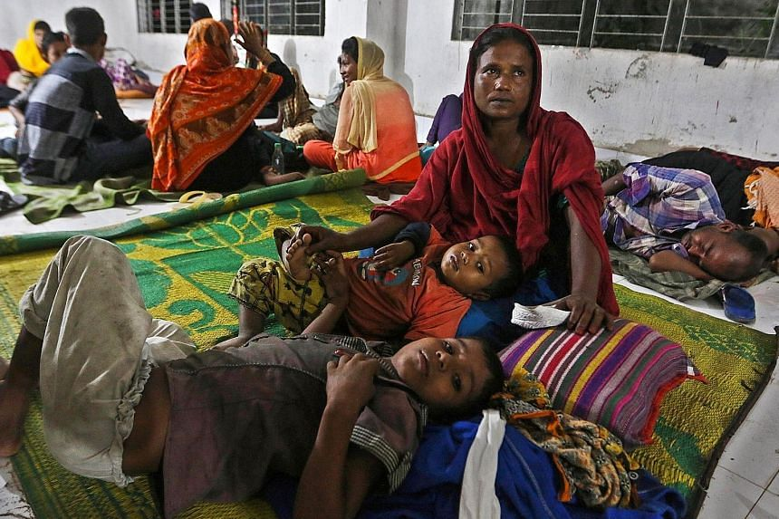Bangladeshi villagers taking refuge in a cyclone shelter on Monday after being evacuated.