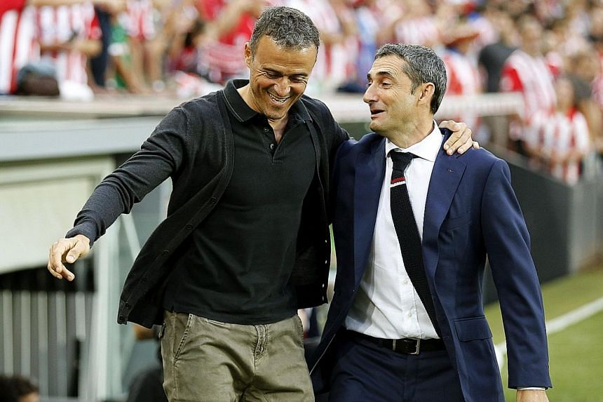 Rival coaches last August when Bilbao hosted Barcelona in a Primera Liga game, Ernesto Valverde (right) has now replaced Luis Enrique in the Barca hot seat and has a huge task reviving their fortunes.