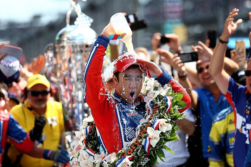 Indianapolis 500 winner Takuma Sato celebrating after becoming the first Japanese driver to triumph in the race. Terry Frei, an American sportswriter, is no longer an employee of The Denver Post because of a tweet linking Sato's feat to World War II.