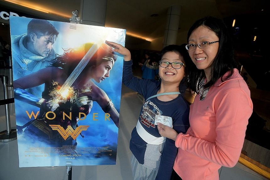 Nathaniel Teo and his mother, Mrs Cherilyn Teo, were among 320 Straits Times readers who won free tickets to watch Wonder Woman yesterday.