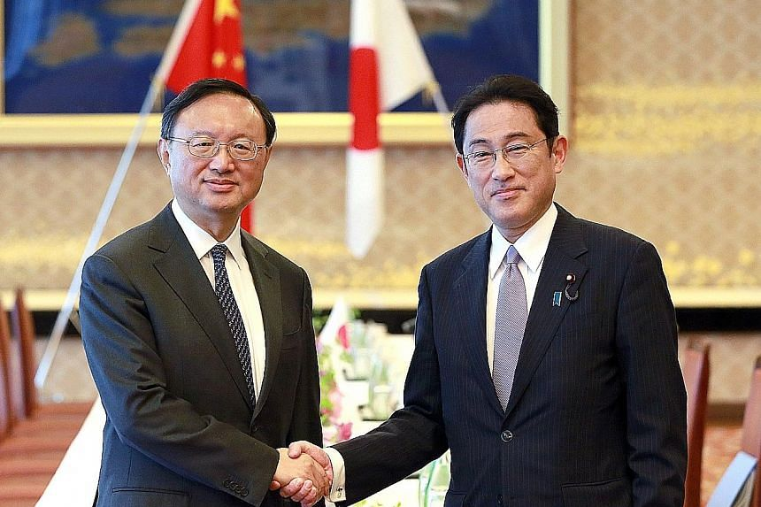 Chinese State Councillor Yang Jiechi (left) and Japanese Foreign Minister Fumio Kishida in Tokyo yesterday. Mr Yang said both countries need to build political trust and said China should be seen as a partner instead of a threat.