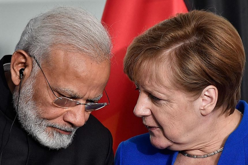 Prime Minister Narendra Modi and Chancellor Angela Merkel agreed on German aid and investments worth $1.54 billion a year.